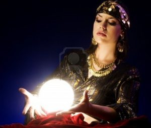 7113279-fortune-teller-reads-the-future-in-glowing-crystal-ball